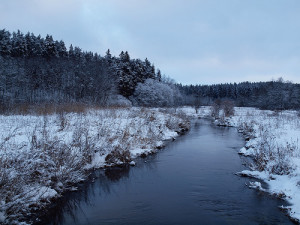 stream with banks covered in snow